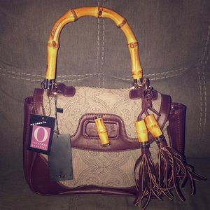 Imoshion brown faux leather and lace handbag